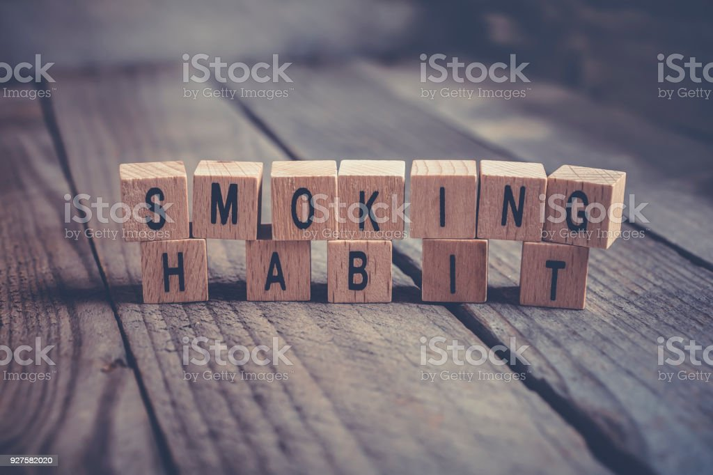 Closeup Of The Words Smoking Habit Formed By Wooden Blocks On A Wooden Floor stock photo