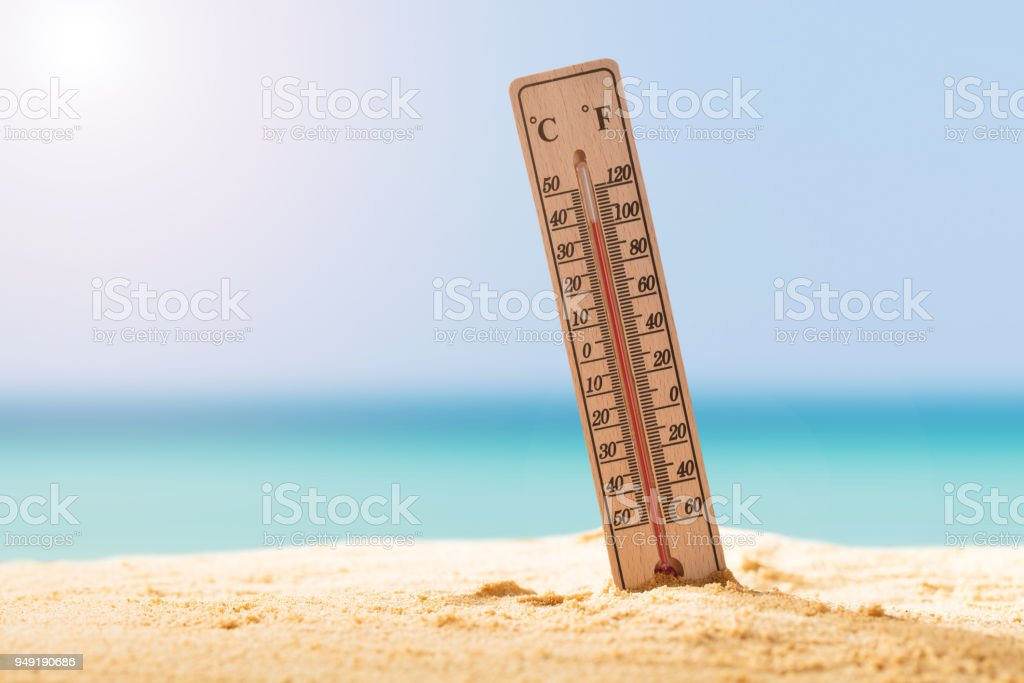 Close-up Of Thermometer On Sand stock photo