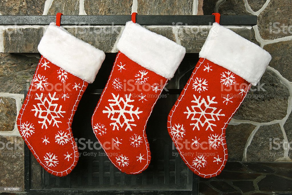 Close-up of three empty Christmas stockings hanging in a row stock photo
