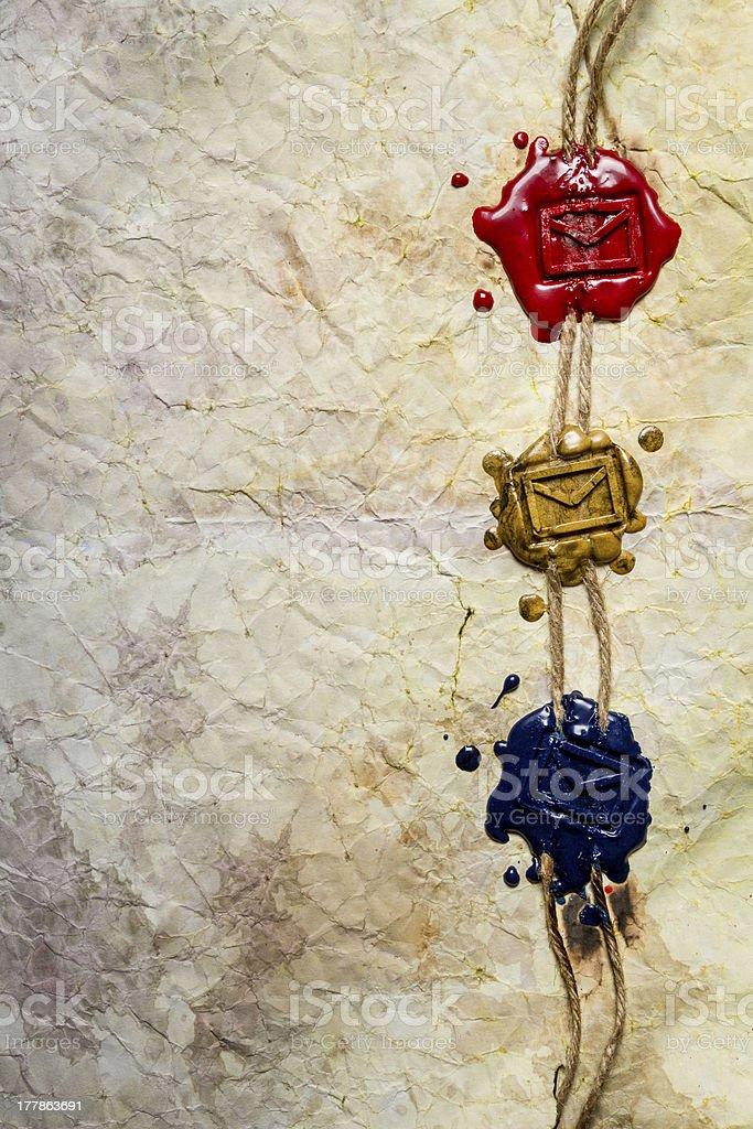 Closeup of three envelope symbol imprinted in sealing wax royalty-free stock photo