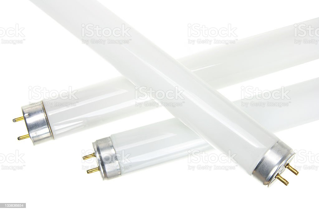 Close-up of three fluorescent tubes over a white background stock photo