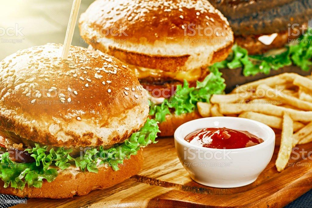 Closeup of three fresh different hamburger stock photo