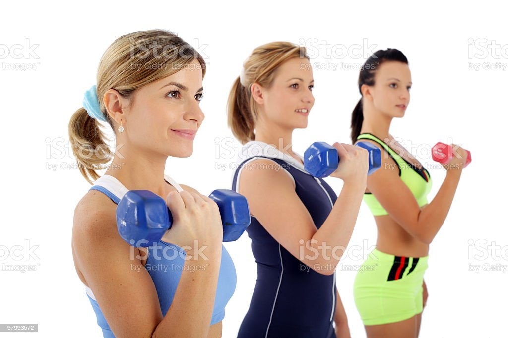 Close-up of three girls with dumbbells. royalty free stockfoto