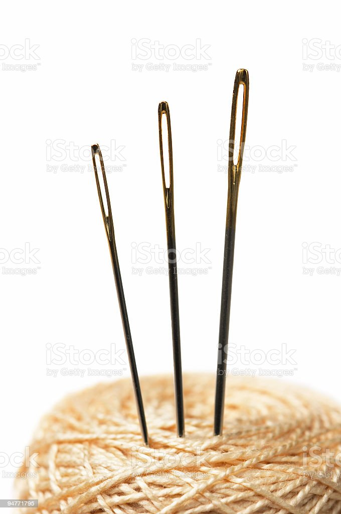 Closeup of three isolated needles in clew stock photo
