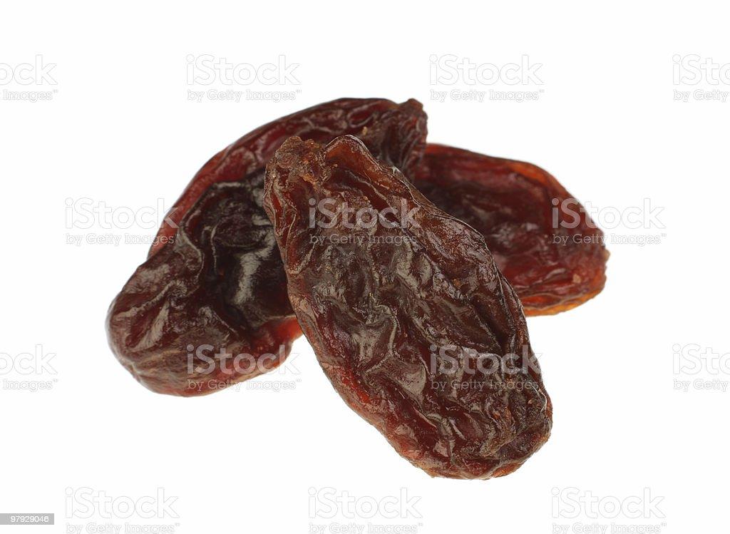 Close-up of three raisins against white background royalty-free stock photo