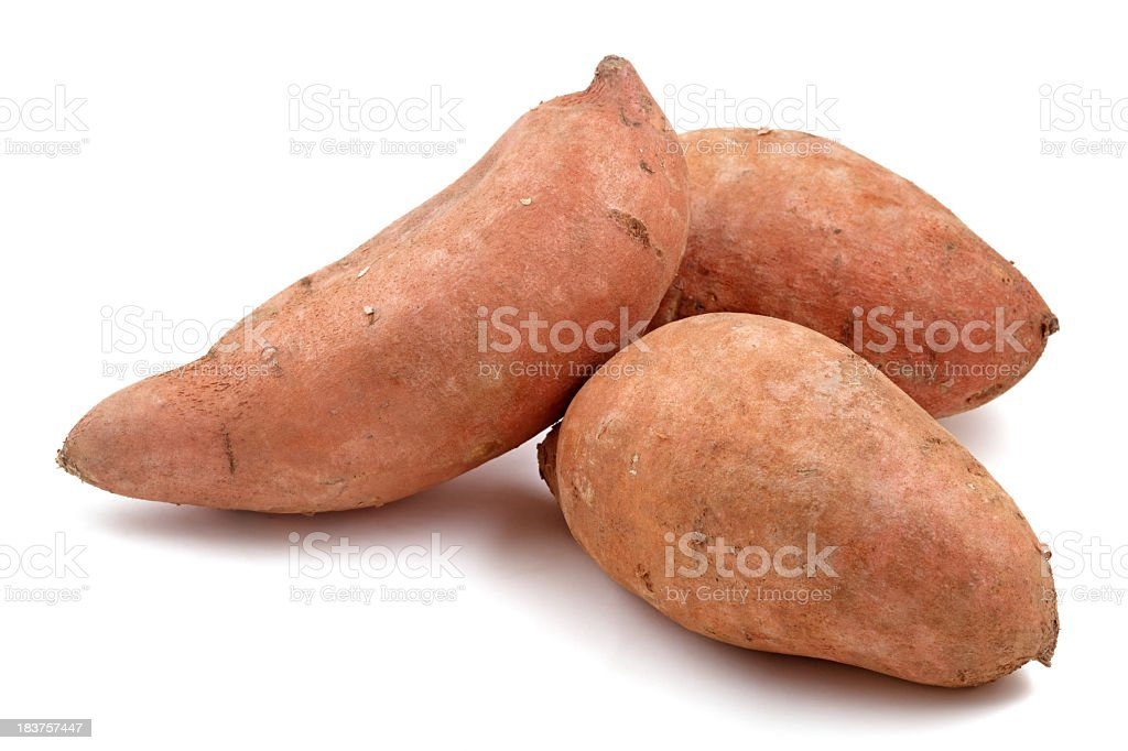 Close-up of three Raw sweet potatoes stock photo