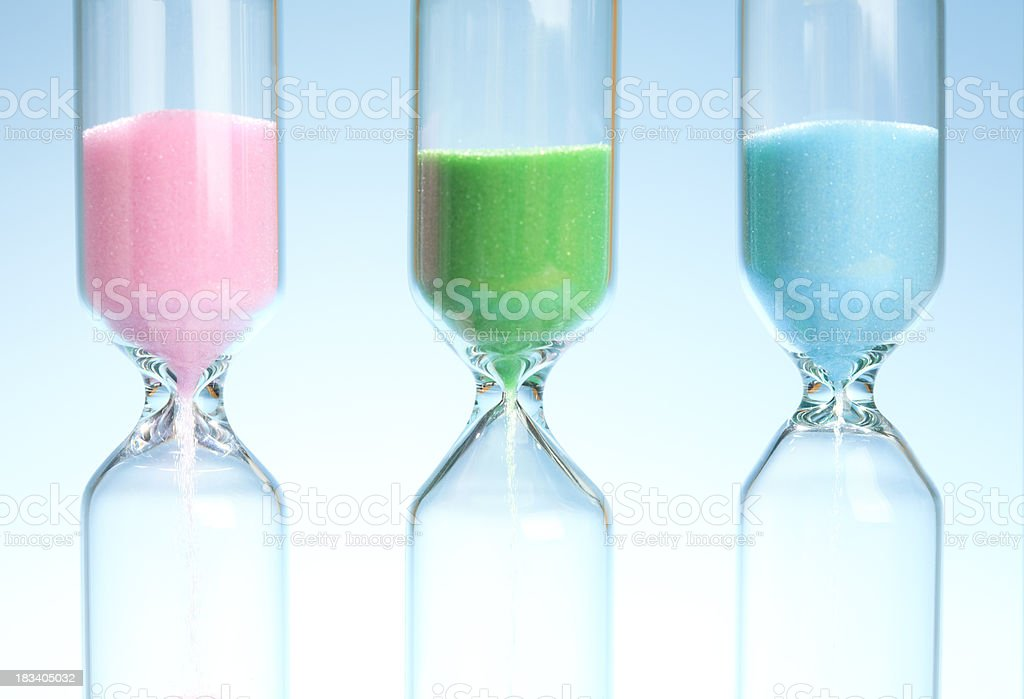 Close-up of three sandtimers (hourglasses) stock photo
