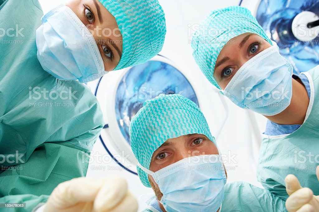 Close-up of three surgeons royalty-free stock photo