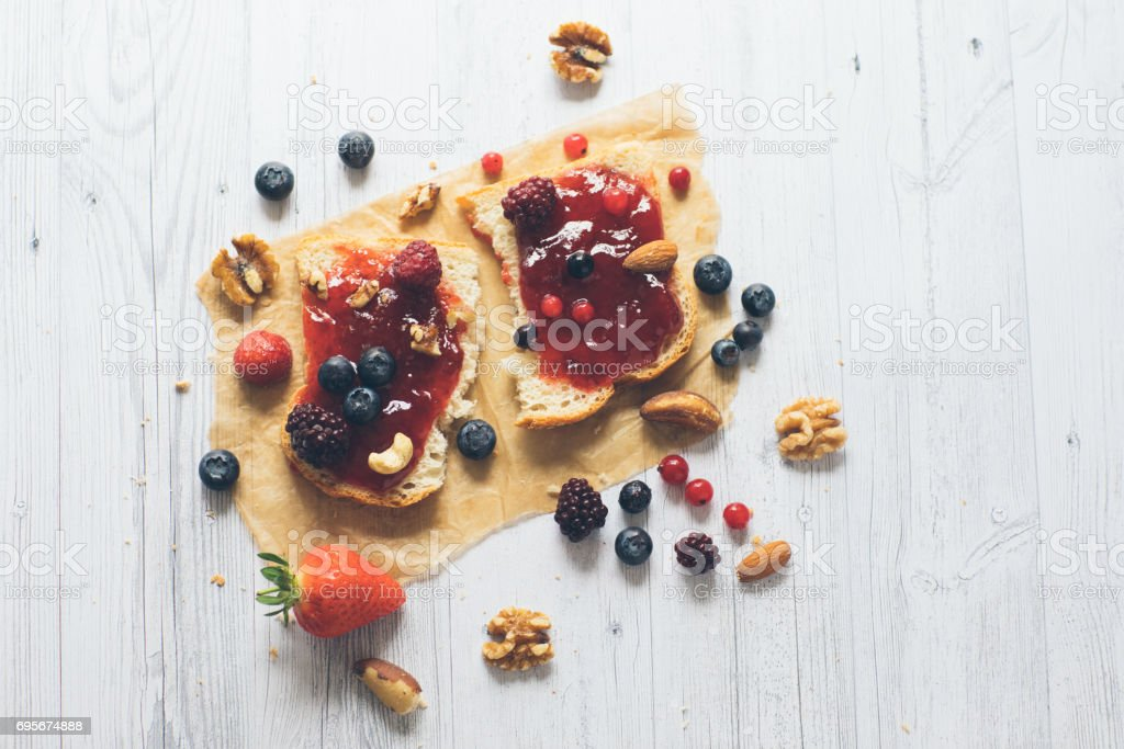 Close-up of toast with homemade strawberry jam on table - Stock image... stock photo