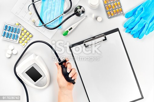 istock Close-up of tonometer by patients arm during blood pressure measuring at medical consultation 917028742