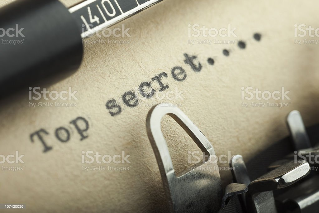 Close-up of top secret message being typed on typewriter royalty-free stock photo