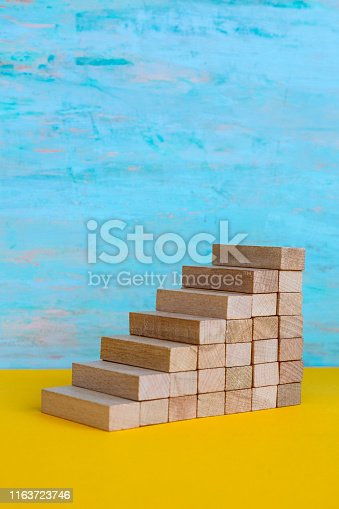 istock Close-Up Of Toy Blocks Against Color Background 1163723746