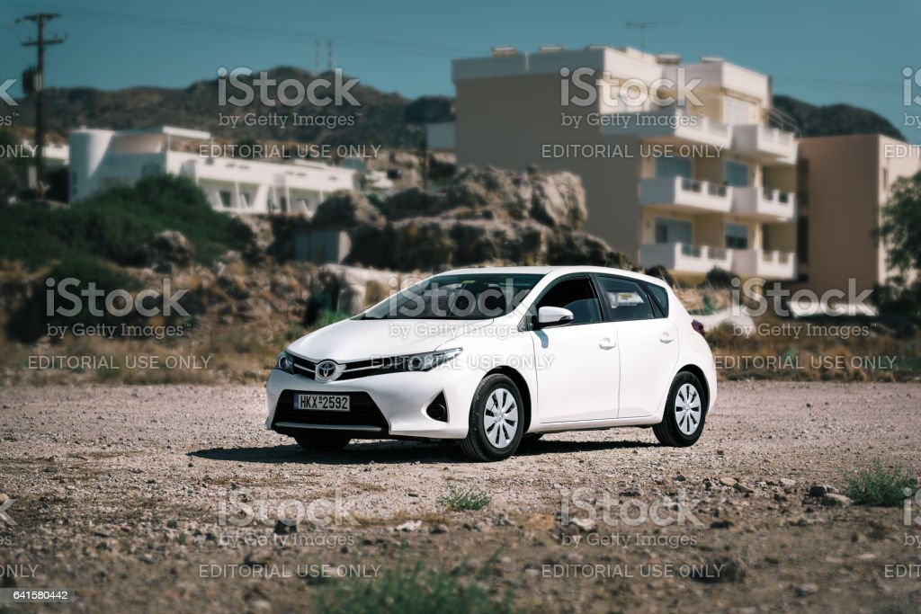 Closeup of Toyota Auris staying on dirty road stock photo