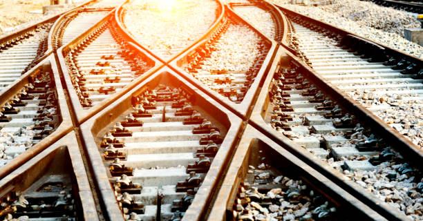 Closeup of train line crossing Closeup of train line crossing crisscross stock pictures, royalty-free photos & images