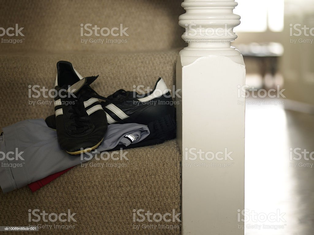 Close-up of trainers and shorts on stairs royalty-free stock photo