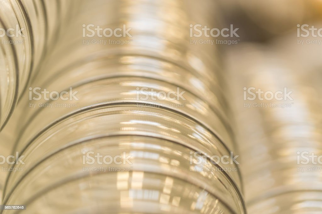 Closeup of transparent plastic corrugated pipe - Royalty-free Black Background Stock Photo