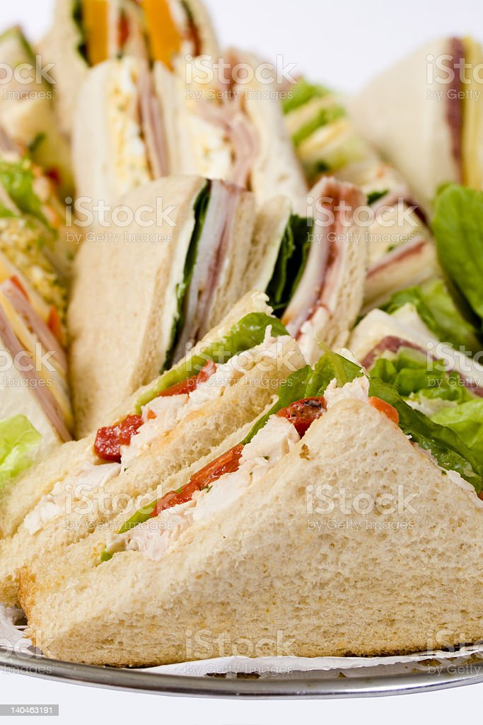 Close-up of triangular sandwiches on a platter royalty-free stock photo
