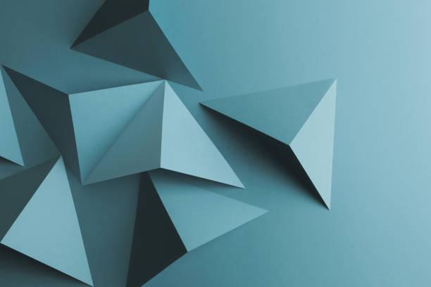 gros plan de formes triangulaires de fond papier, abstraite - origami photos et images de collection