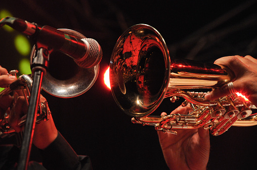 Closeup Of Trumpets Being Played Into Microphone Stock Photo - Download Image Now