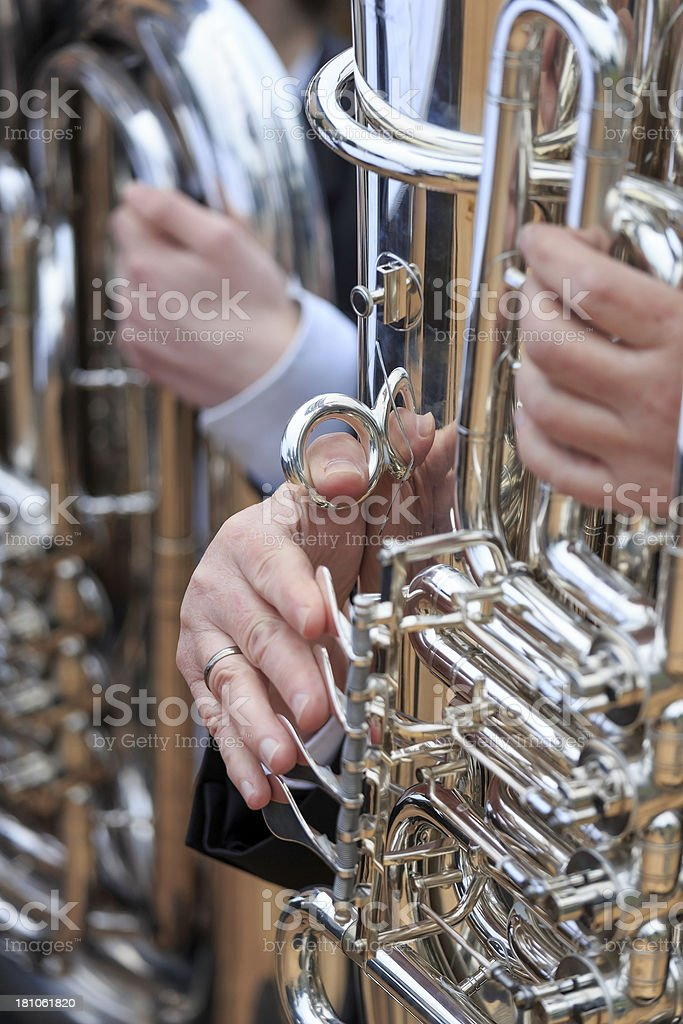 Close-up of tuba's played in orchestra at an outdoor concert royalty-free stock photo