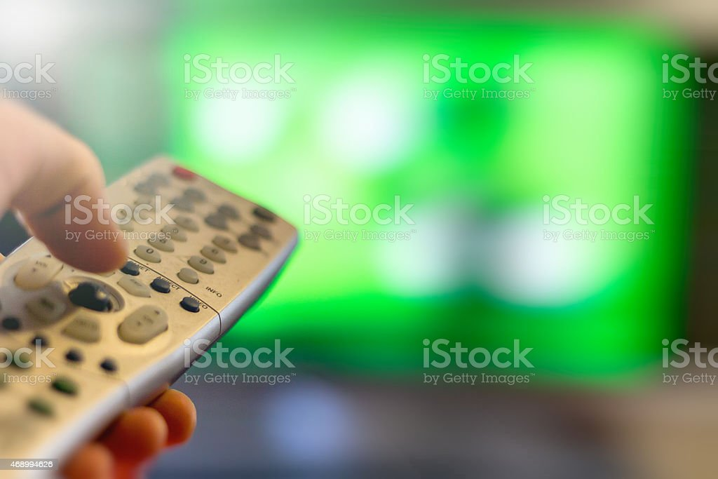 Close-up of TV remote control over a blurred background stock photo