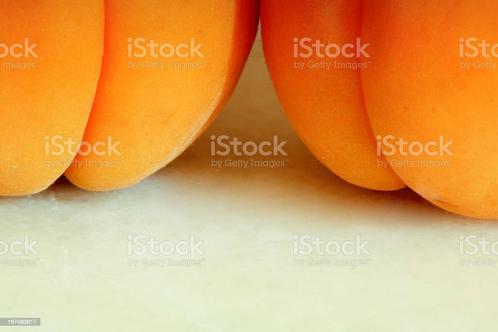 Close-up of two apricots on a white table stock photo