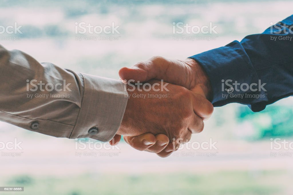 Closeup of Two Businessmen Shaking Hands stock photo
