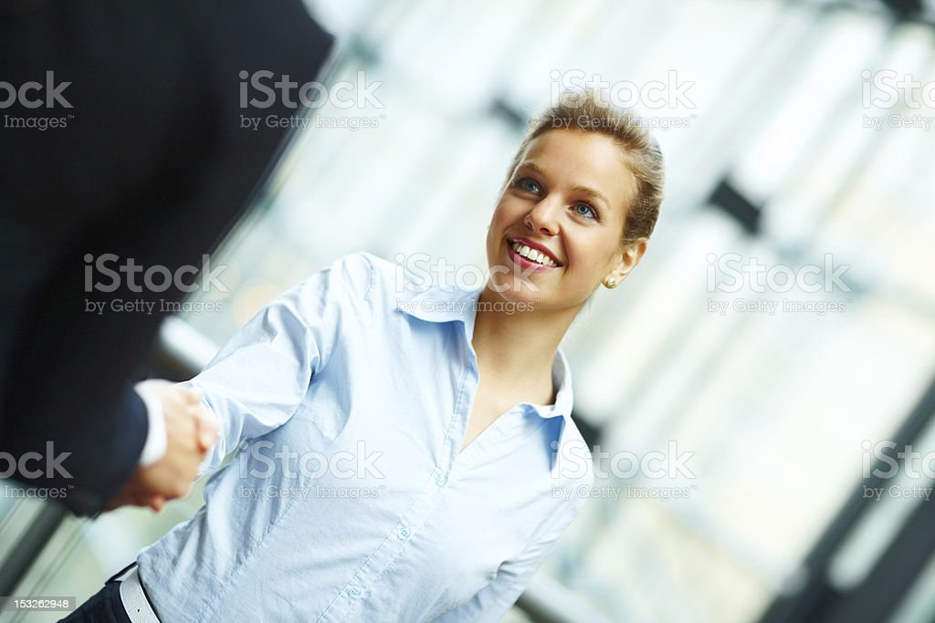 Close-up of two businesswomen shaking hands royalty-free stock photo