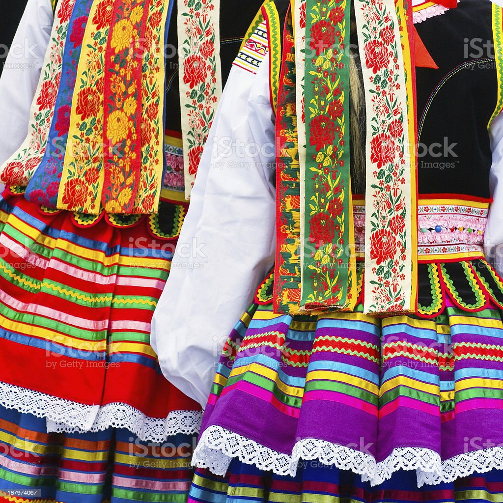 Close-up of two ethnic costumes stock photo