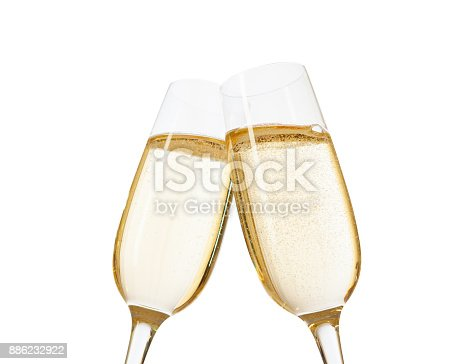 Close-up of two glasses of Champagne clinking together.  Isolated on white  background. Focus on near glass.