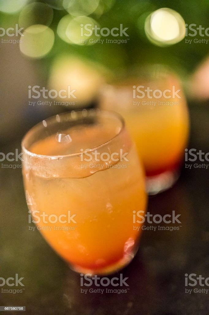 Close-up of two glasses of Tequila sunrise cocktails just waiting to be savoured. stock photo