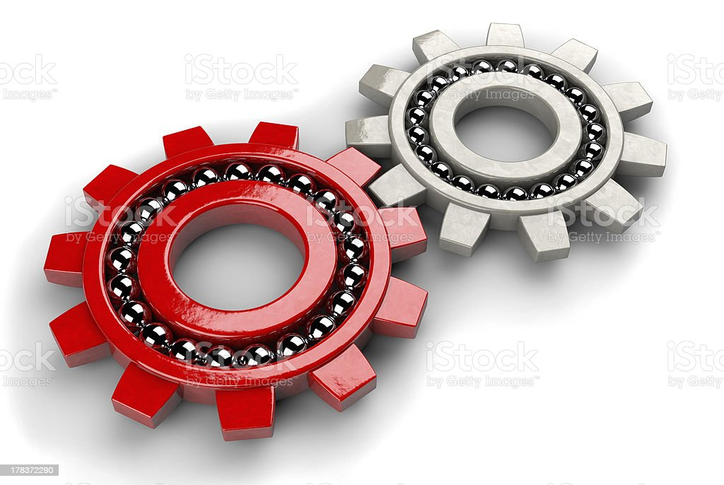 Closeup of two gray and red gear bearings royalty-free stock photo