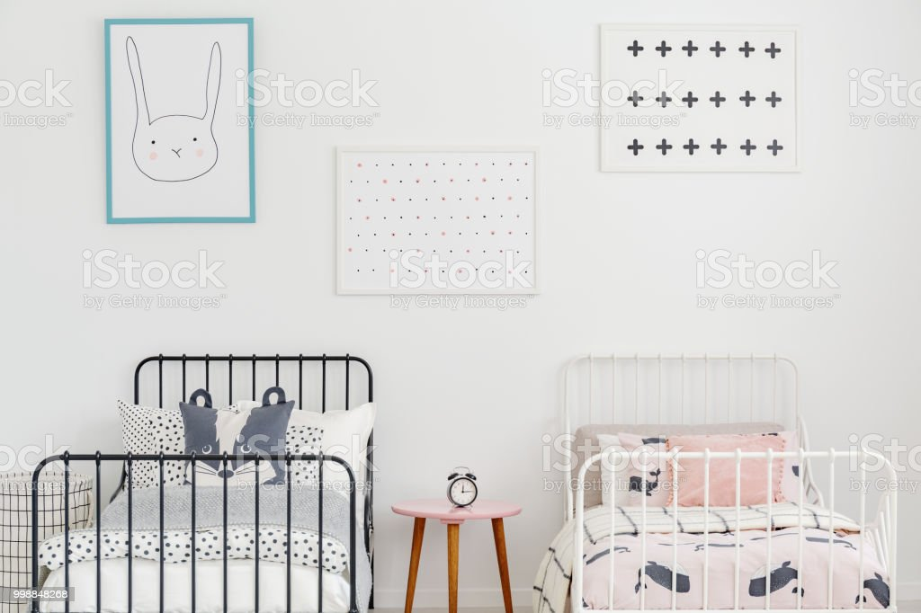 Fantastic Closeup Of Two Metal Frame Beds With Bedding And Posters On Download Free Architecture Designs Viewormadebymaigaardcom