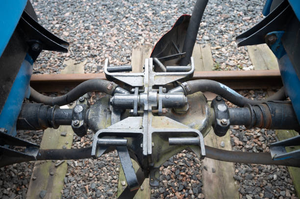 A closeup of two old train couplers connected together stock photo