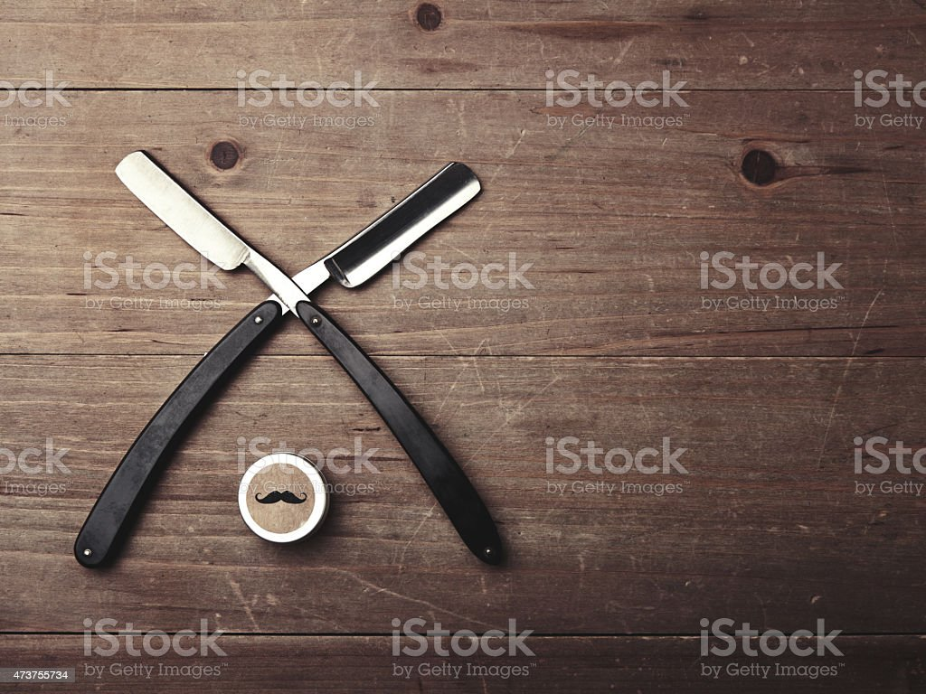 Closeup of two razors and wax box stock photo