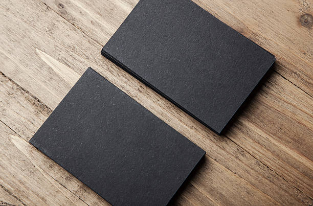 Royalty free business card pictures images and stock photos istock closeup of two stack of blank black business cards on stock photo accmission Gallery