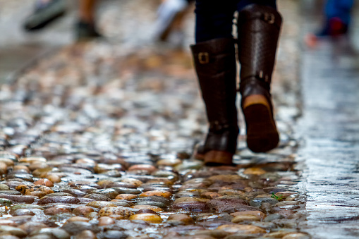 Closeup Of Unfocused Womans Feet On A Cobbled Street Stock Photo - Download Image Now