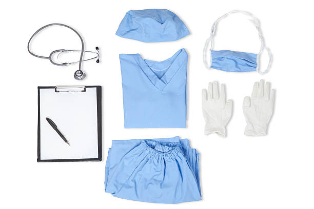 Closeup of uniform for surgeon Equipments of surgeon with uniform, stethoscope, clipboard, gloves, mask, and hat surgical cap stock pictures, royalty-free photos & images