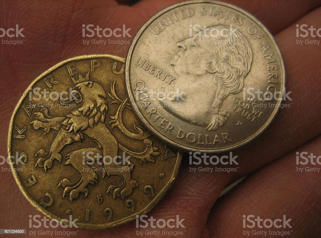 Close-up of USD Quarter and 20 CZK Coin in Hand stock photo