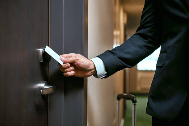 Close-up of using keycard to open the door or scan keycard open door for chance Businessman in hotel. Close-up of using keycard to open the door or scan keycard open door for chance cardkey stock pictures, royalty-free photos & images