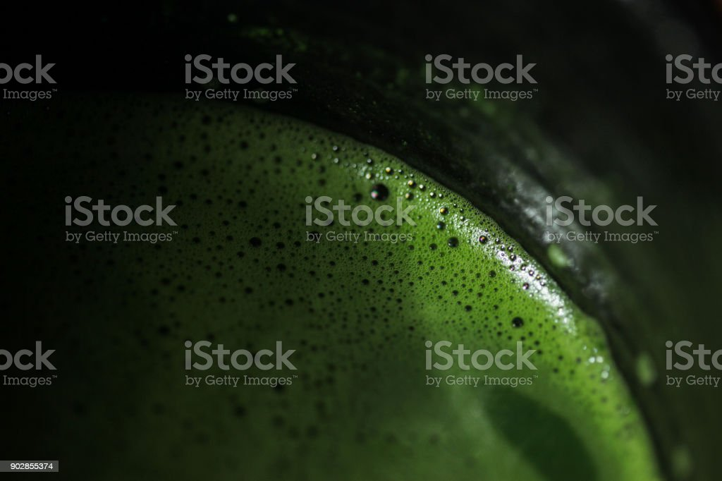 Closeup of usucha in a black bowl stock photo