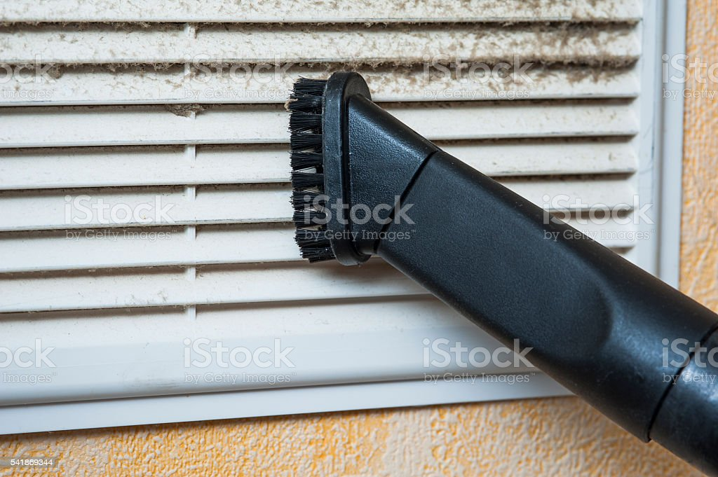 Closeup of vacuum cleaner pipe and ventilation grill stock photo