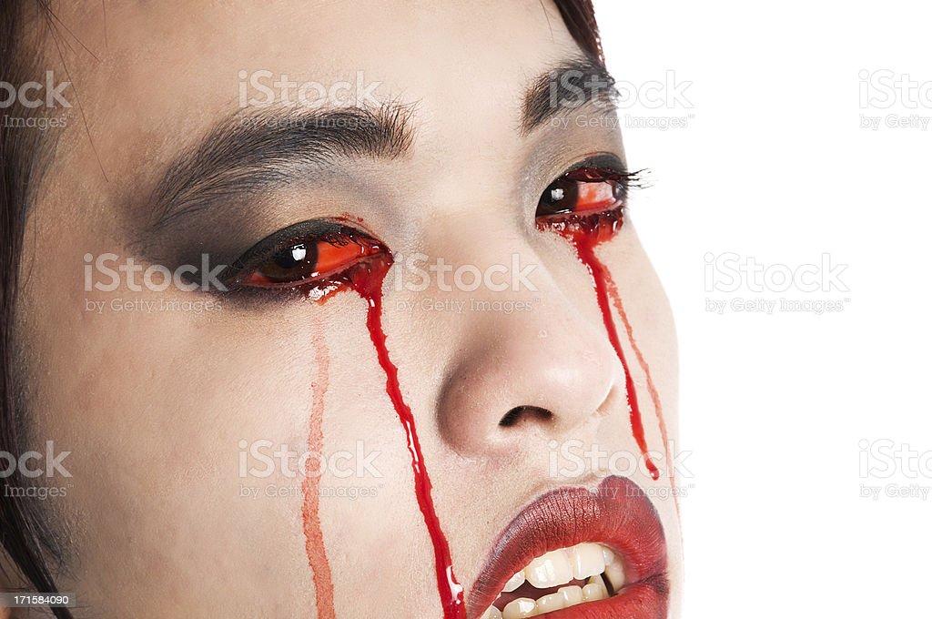 Closeup of vampire crying blood. royalty-free stock photo