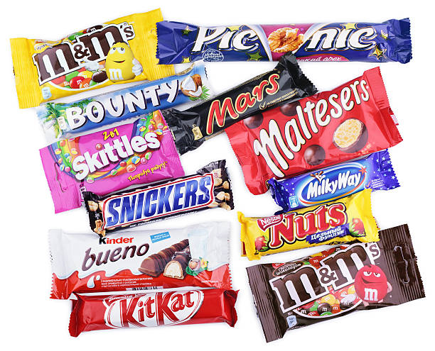 closeup of various chocolate bars on white - kit kat stock photos and pictures