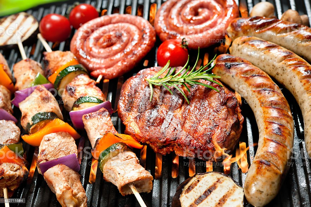 Close-up of various meat products on a grill stock photo