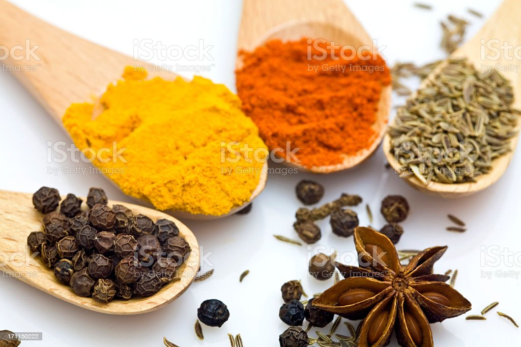 Close-up of various spices in wooden spoons royalty-free stock photo