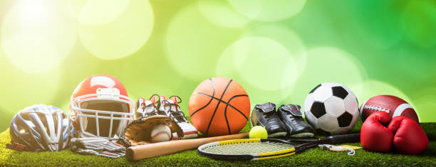 Close-up Of Various Sport Equipments On Pitch stock photo