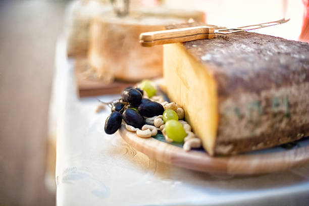 close-up of various types of cheese as appetiser at vintage - appetiser stock photos and pictures