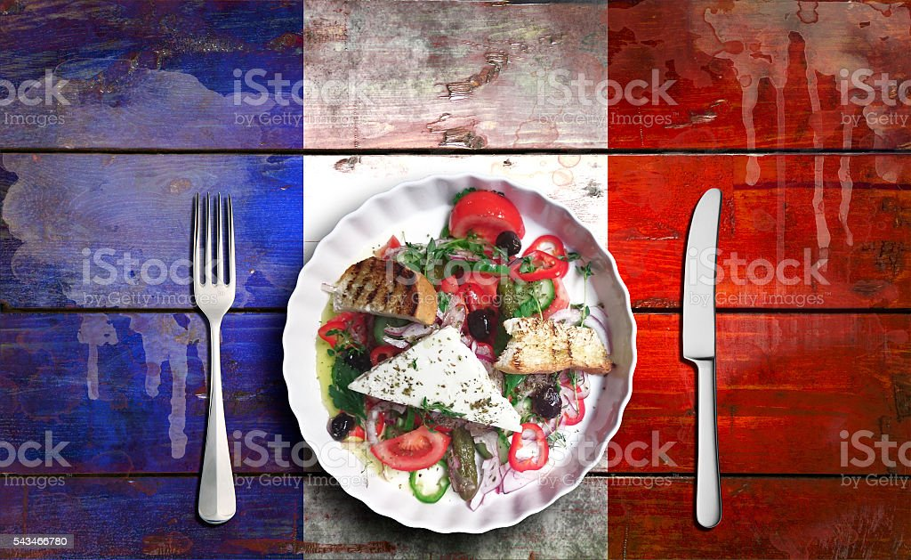 Closeup of vegetable salad on Flag of France stock photo