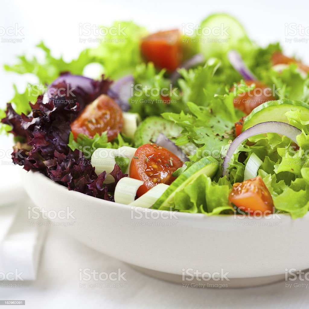 Closeup of vegetable salad on white background stock photo